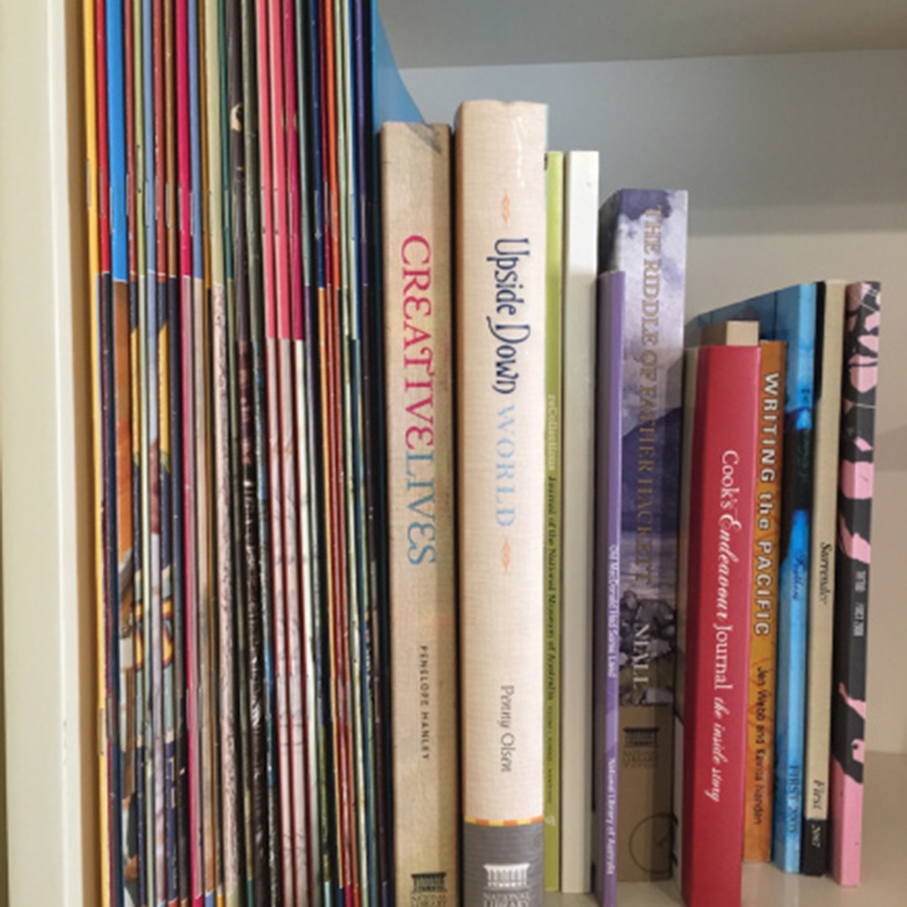 A shelf of books and periodicals editor Lee Ellwood has worked on